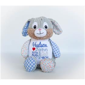 This is an image of a personalised patchwork bunny cubby blue baby gift from My Teddy