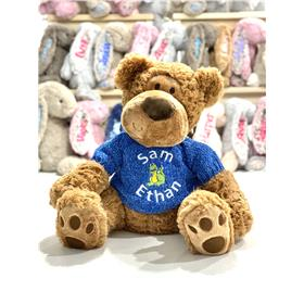 Milo teddy with blue knit embroidered with a personalised message.
