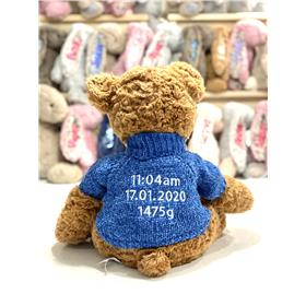 Personalised Teddy bear in blue knit with birth details embroidery in white.