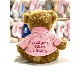 Personalised teddy bear in pink knit with hot pink birth details