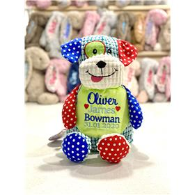Personalised Patchwork Puppy embroidered with a personalised birth template in blue, with red heart accent.