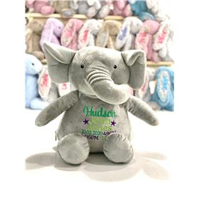Personalied elephant with embroidery in greens and purple.